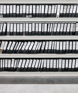 Shelves of box folders