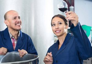 Man and woman testing wine