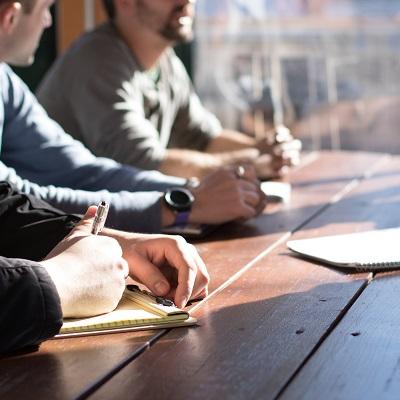 Team around a desk in meeting