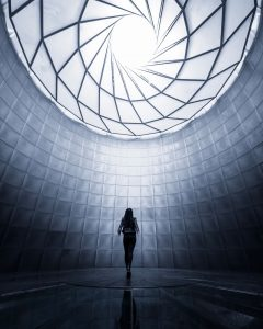 Woman looking up to a futuristic ceiling